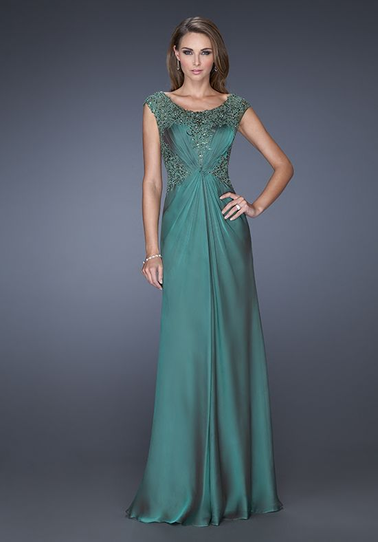 79354ab513e Beautiful evening gown with a lace overlay and fitted belt. Embellished  with jewels along the bodice