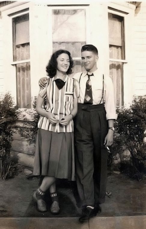 1940s couple. Love his high waisted pants and short tie.