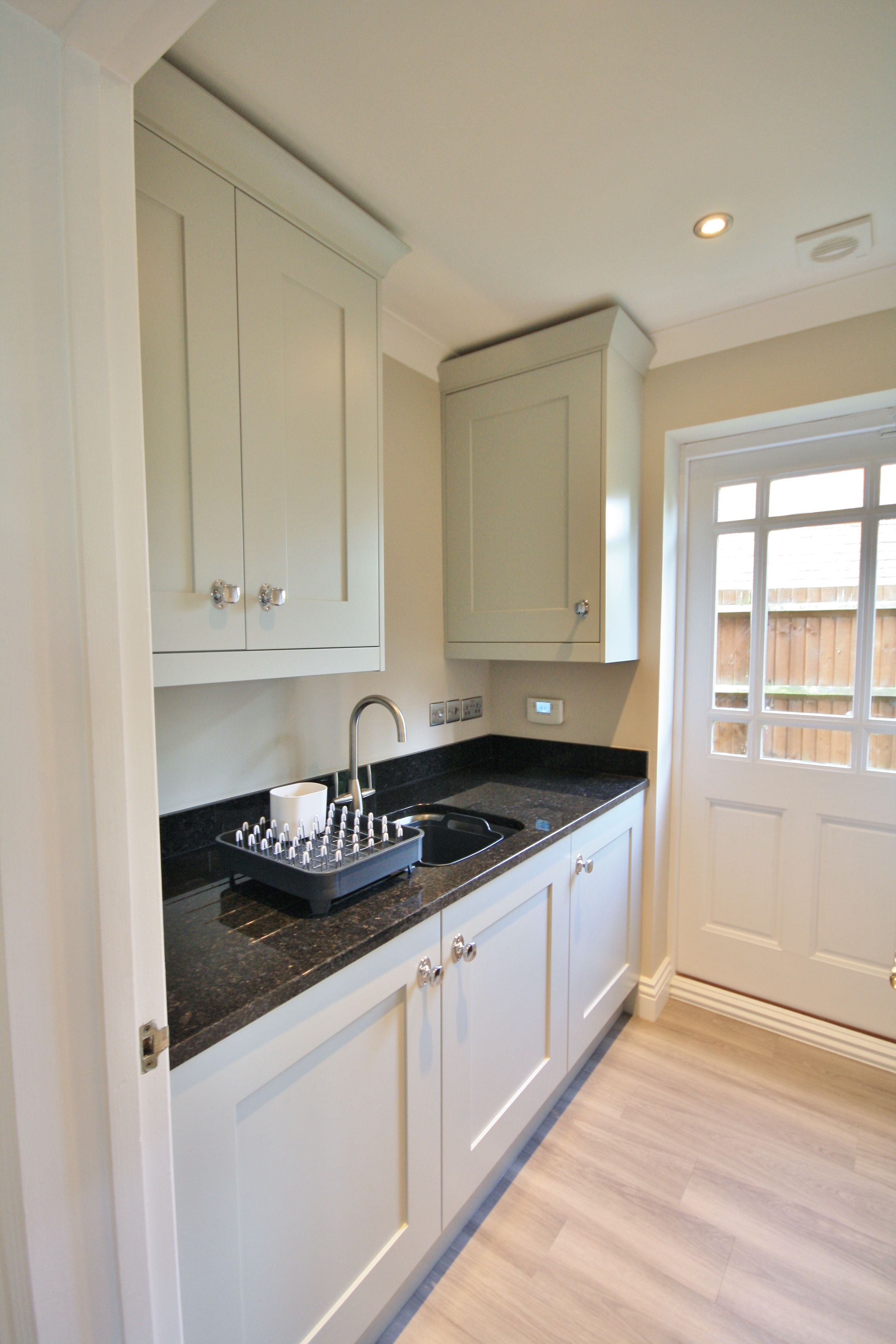 Matching Partridge Grey Utility With Black Granite Worktops And Up
