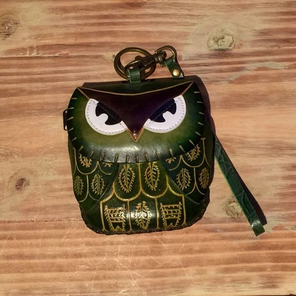 Handmade Owl Coin Purse Handmade Owl Coin Purse - 100% All Leather. Unique and cute coin purse featuring hand tooled leather designs. Removable wristlet strap and keyring at the top. Owl face secures via magnetic snap, underneath is a zipper to access the inside of the coin purse. Big enough to carry a few cards and ID, cash, lip balm or lipstick and keys. Excellent condition! Never used. Purchased from an artist at Bonnaroo! Accessories Key & Card Holders