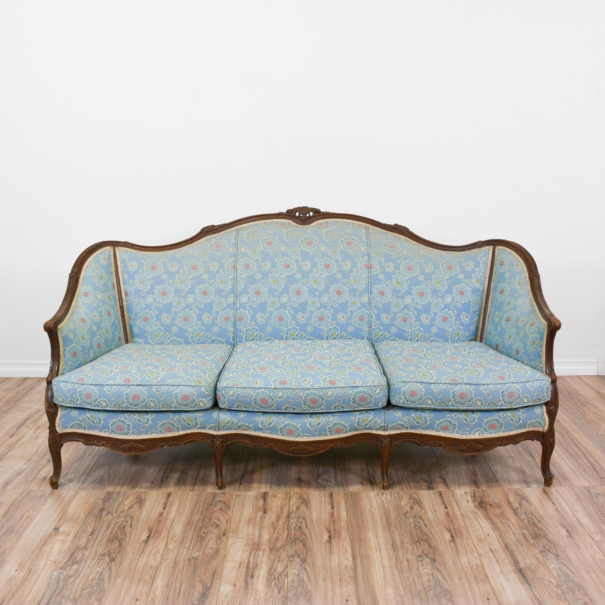 This French Bergere style sofa is upholstered in a durable light