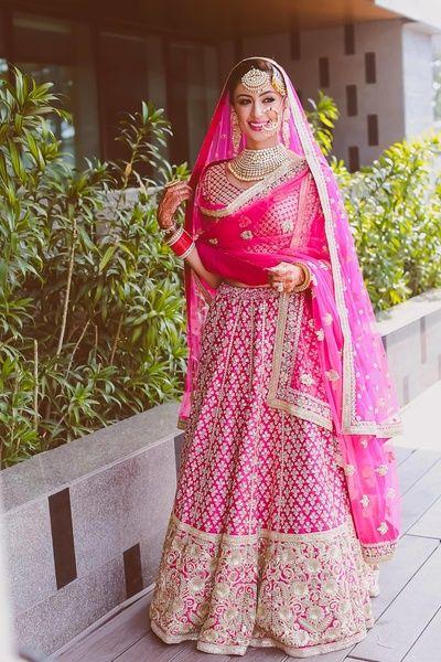 sikh bride, morning wedding, bridal lehenga, pink bridal lehenga, all over lehenga, small booti, small motif lehenga, large border, double dupatta, two dupatta, sikh bride, sardarni bride , nosering, maang tikka,