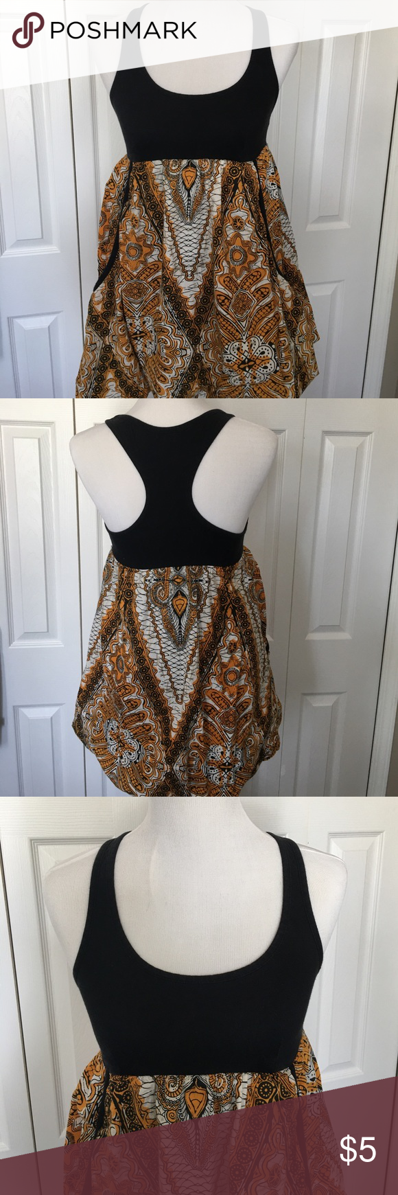 Black and Orange Patterned Sundress Super cute black with an orange pattern dress. The sides have hand pockets. Size M. 100% Cotton material. Fire Los Angeles Dresses Mini