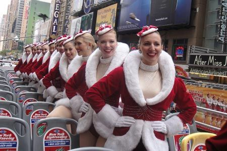 Radio City Rockettes pose on a double-decker Gray Line