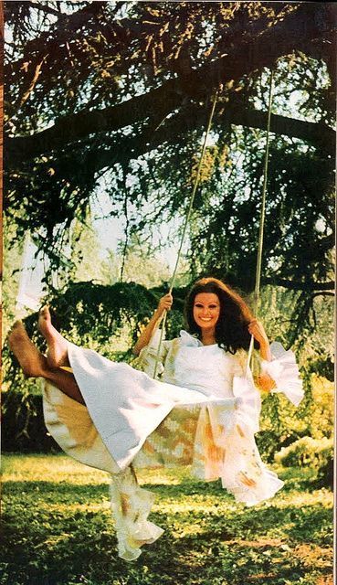 A carefree Sophia Loren in her gardens. Photo by Lord Snowdon, Summer gown by Dior. UK Vogue March 1971.