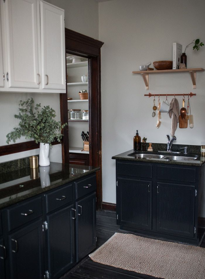 black base cabinet and white upper cabinets in a simple and clean ...