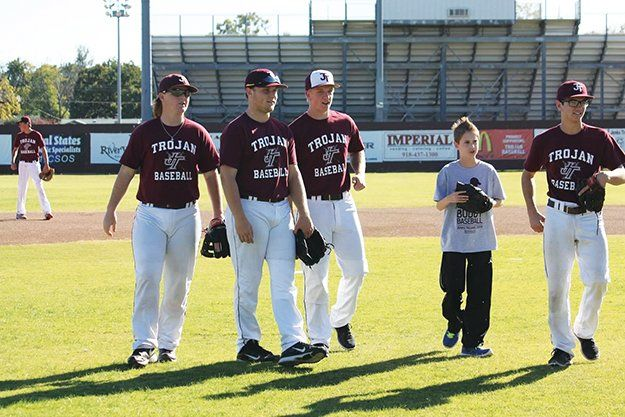 The Jenks baseball program will host its 10th year of Buddy Baseball this month. Students ages 7-18 with autism are paired with Jenks baseball players to practice batting, fielding and running. Pictured are students from the 2013 Buddy Baseball game.