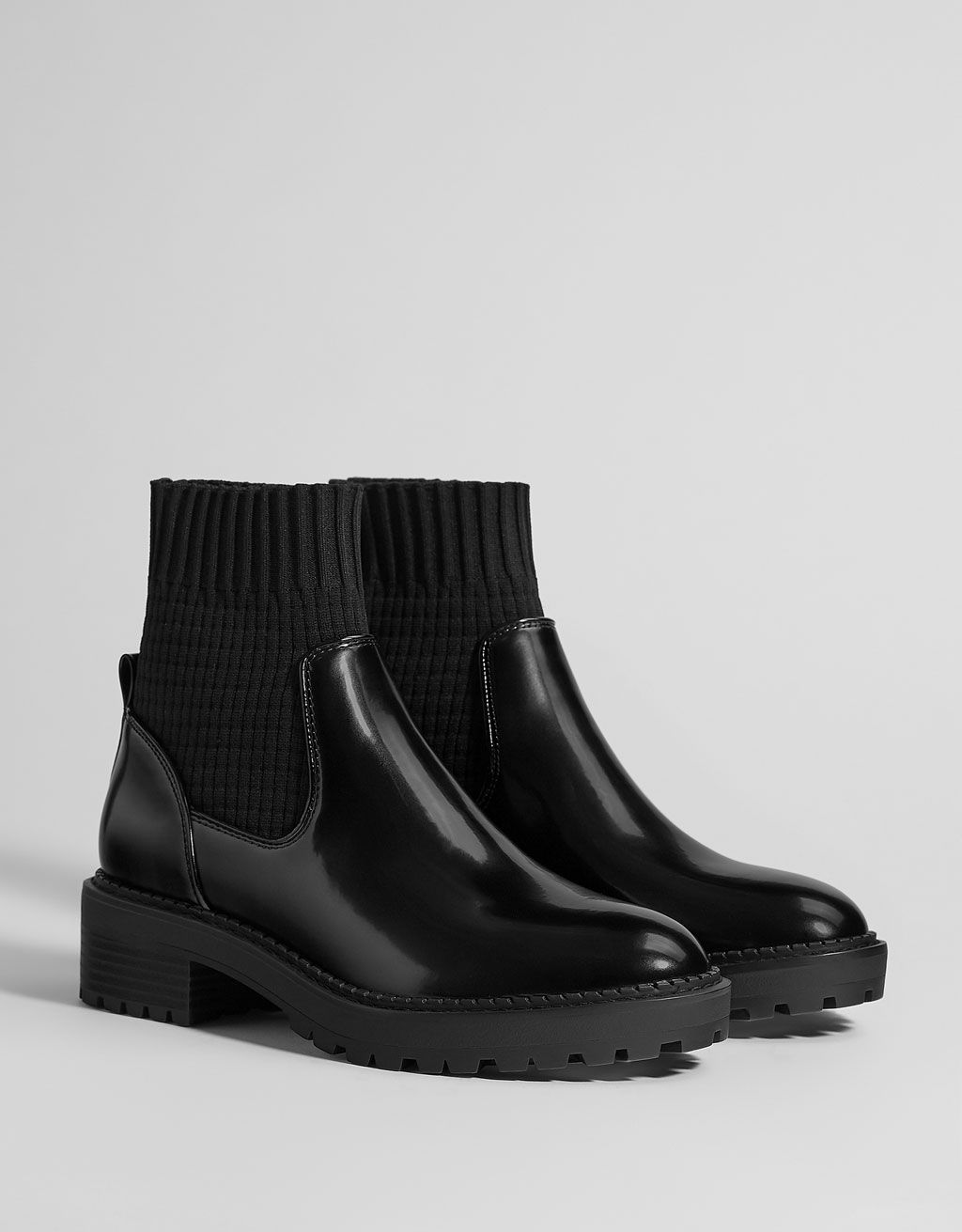 9c593ff0fed FLAT SOCK-STYLE ANKLE BOOTS BLACK ANKLE BOOTS WITH TRACK SOLES. FEATURIN  (IDR 699