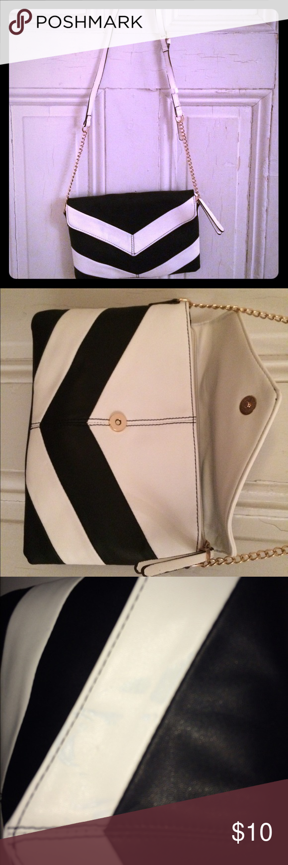 Black and white faux leather purse Gold chain and white faux leather band. Zipped pocket inside. Slight blue stain on flap. Bags Shoulder Bags