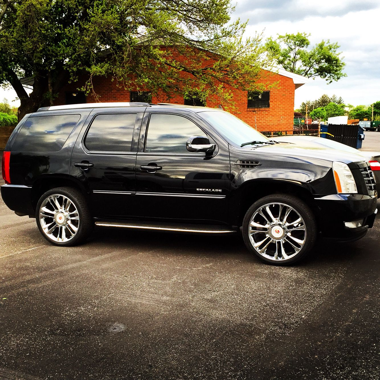 24 platinum replicas in chrome on a cadillac escalade