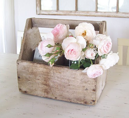 Vintage wooden garden tool box looks so charming with spring flowers
