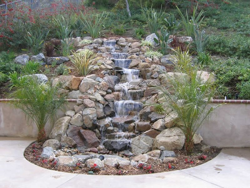 Pondless waterfall garden ideas pinterest water for Waterfall garden feature
