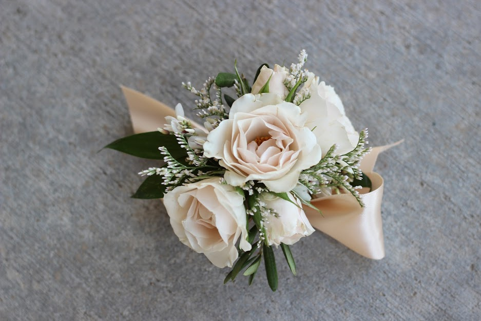 Wrist Corsage Spray Roses With Caspia And Italian Ruscus On A Stain Ribbon Wrist Tie Celebration Flair Spray Roses Italian Ruscus Corsage