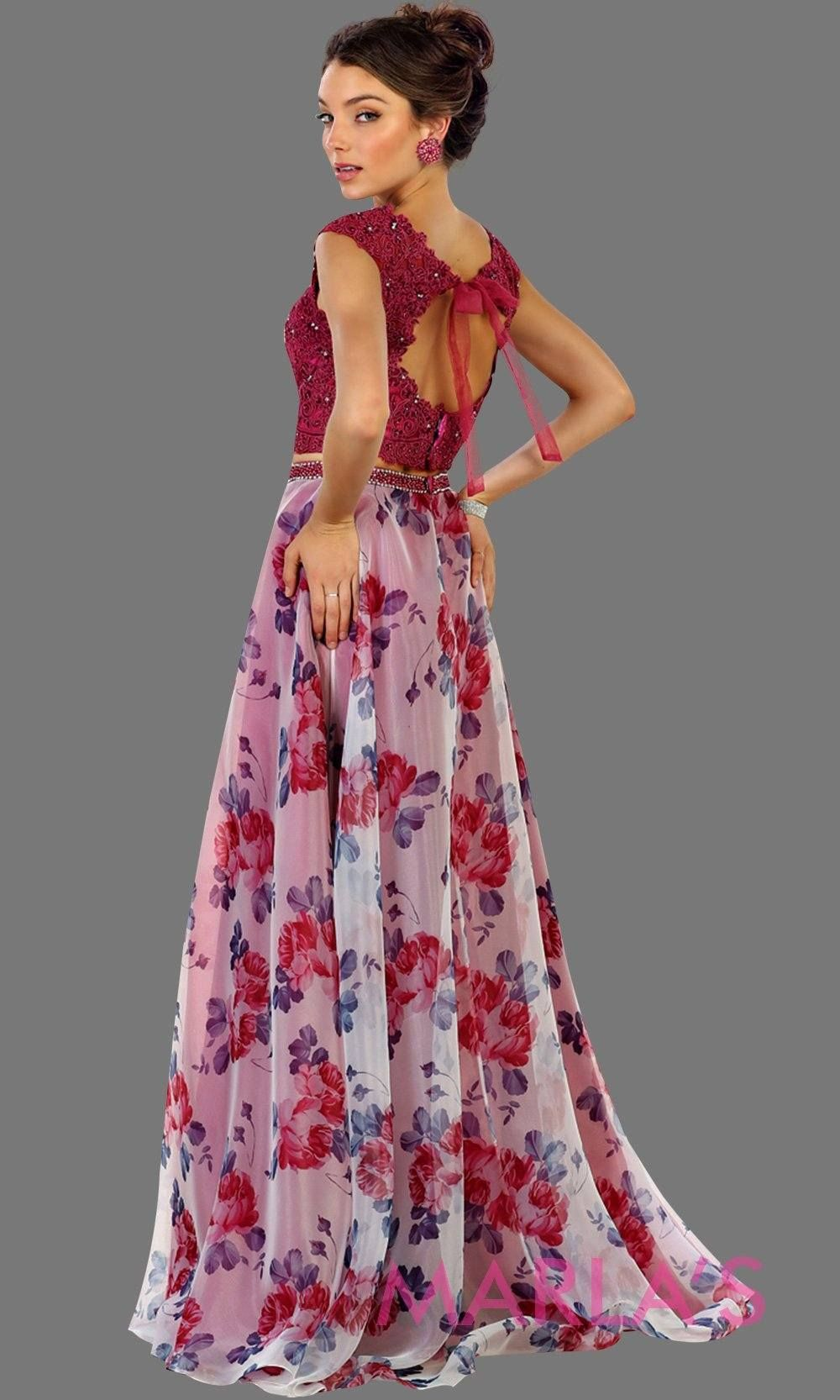 0ed6c2764b9 Long two piece hot pink dress with floral skirt and lace top. It has a flowy  skirt. This flower print dress is perfect for prom