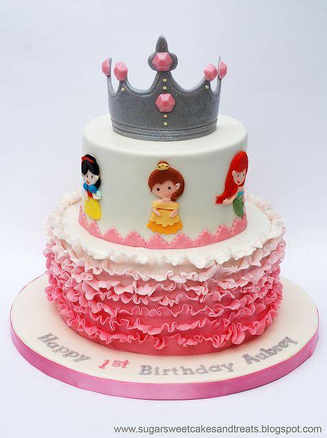 Disney Princess Cake by Angela Tran (Sugar Sweet Cakes & Treats). Gumpaste Tiara/Crown, Pink Ombre Ruffles and 6 Princesses (Belle, Snow White, Tiana, Cinderella, Rupunzel, Ariel). | Disney Cakes | Disney Cake Ideas | Disney Princess Cakes |