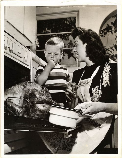1950s anon Acme photo agency - mom basting thanksgiving turkey - front  Vintage thanksgiving