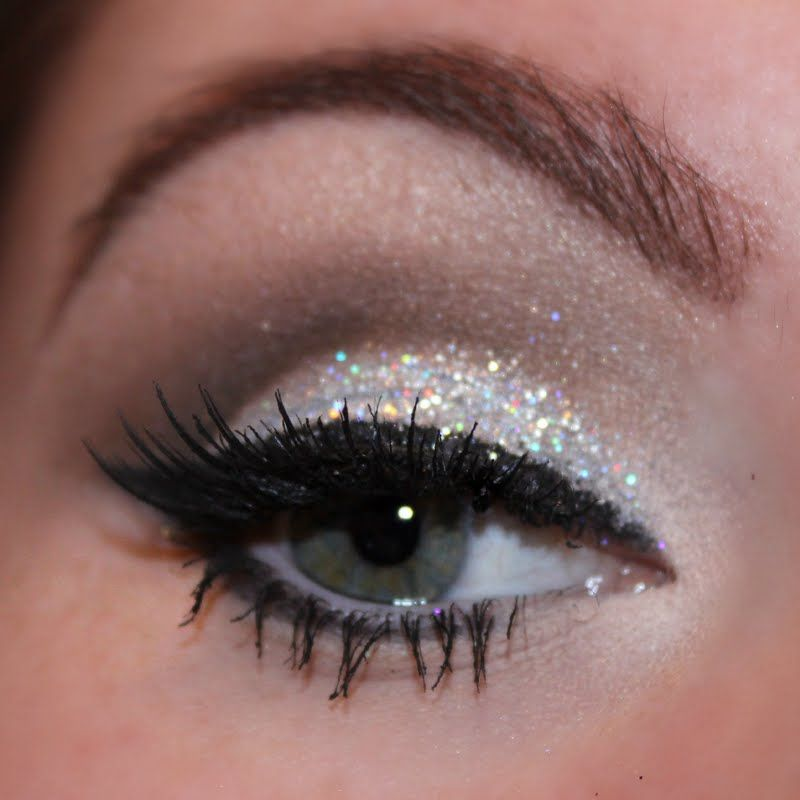 Glamorous cut crease with silver glittery lids are featured on ...