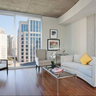 Living room at glass house by windsor in uptown dallas