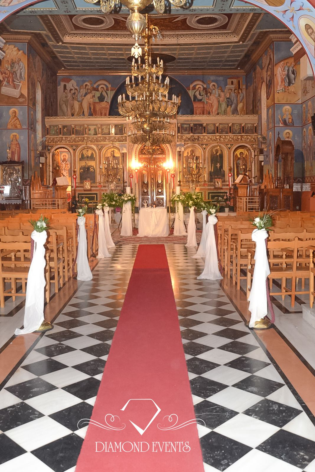 Decorated pillars corridor church with white gauze and