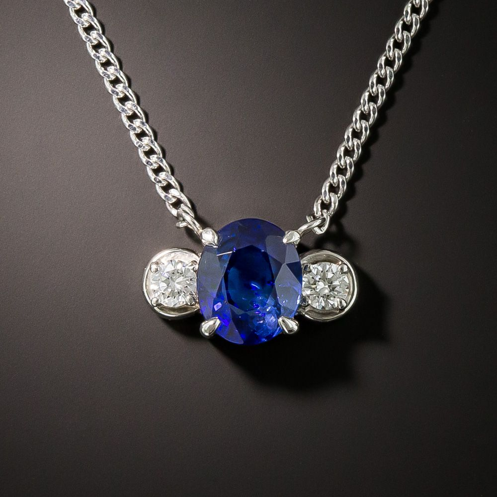 The Traditional Three Stone Design Has Been Nicely Adapted Into A Drop Necklace Featuring A Bright Royal Blue Faceted Oval Sapphire W Jewelry Diamond Necklace
