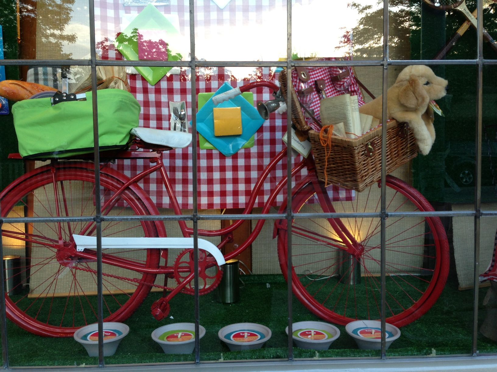 A red bike provides a focal point for this window filled