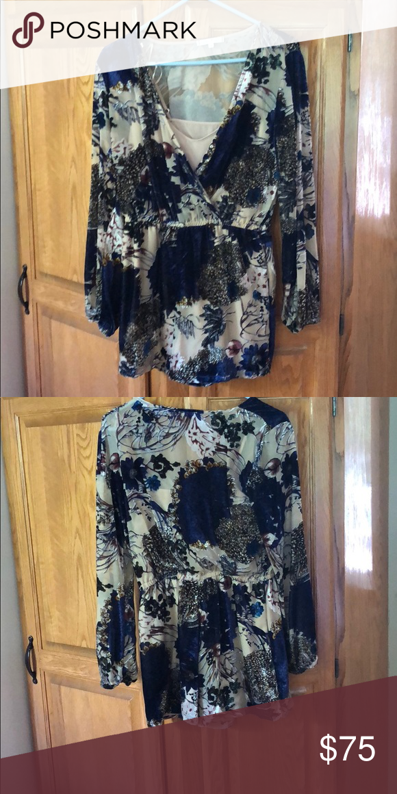 537f61ed8374 Floral and Velvet Romper Super cute long sleeve romper from a boutique! The  floral details are made out of velvet and comes with a nice tan built in  slip ...