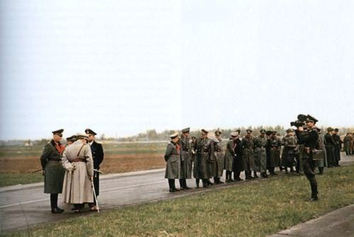 Göring, Keitel, Dönitz and other high ranking German officers waiting for the arrival of Hitler, April 20, 1944, Hitler's birthday. The man with the camera is Walter Frentz, nicknamed the Führer's cameraman.   Flickr - Photo Sharing!
