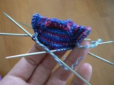 Tee-Tiny Raglan Ornament This is a basically a scaled-down pattern for a seamless, top-down sweater. I knit mine using leftover sock yarns, and the finished pieces weighed between 4 and 6 grams, so…