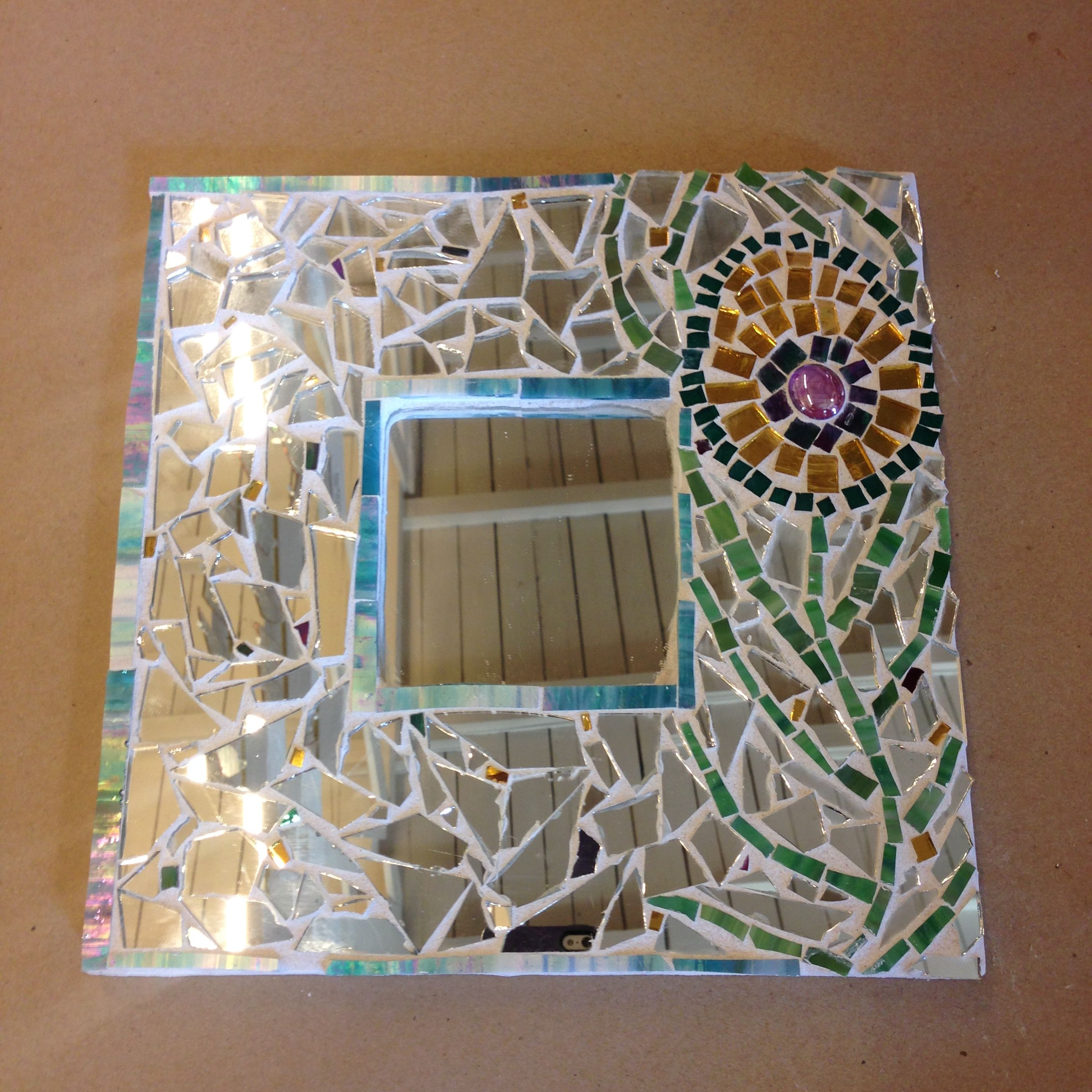 Mosaic flower mirror using mirrors and colored glass
