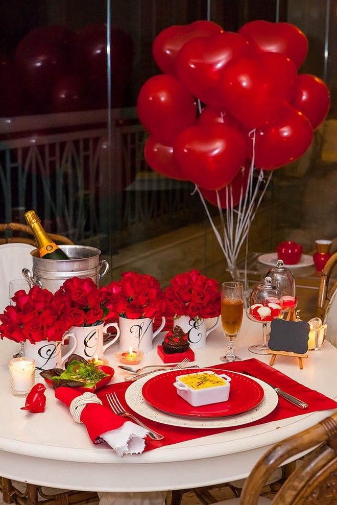 Valentine\'s day dinner table setting with roses and balloons ...