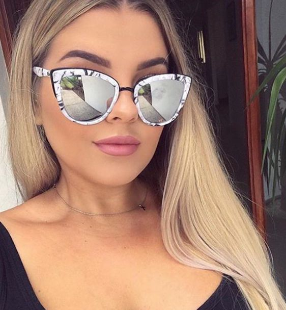 80aae8081ec These modern cat eye sunnies feature plastic coated metal frames ...