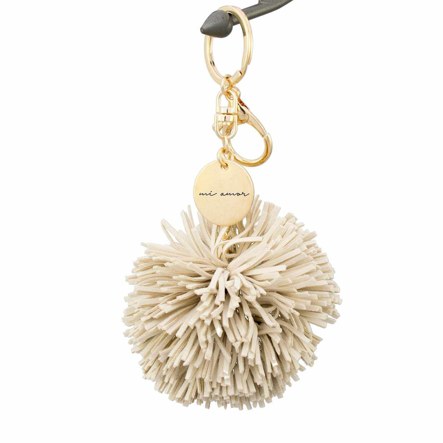 Handmade suede pom tassel keychain. This stylish keychain is made of luxe suede and comes in 5 chic colors. Clip to your tote, purse or add your keys for a keychain that's super easy to find in your bag! Features a charm with your choice of Italian love phrase laser-engraved. Makes the most romantic gift for your wife or girlfriend for Valentine's Day, birthdays or anniversaries. Love Phrase Italian to English Translation:Vita Mia - My LifePer Sempre - ForeverTi Amo - I love YouMi Amor - My Love