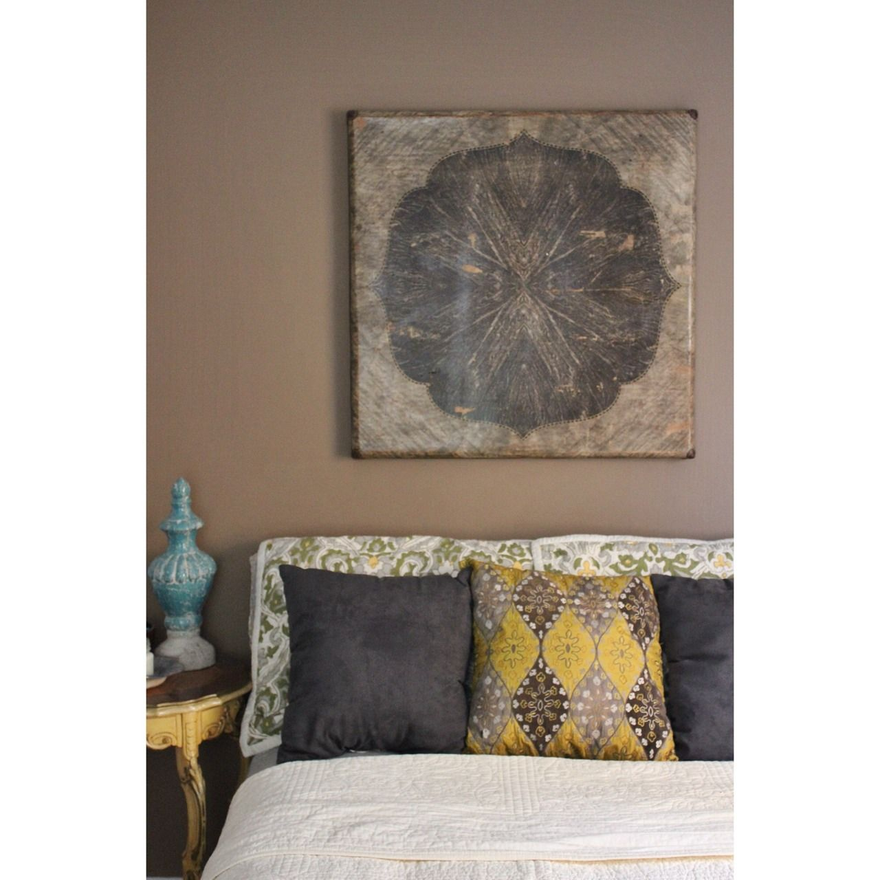 Neutrals with pops of color in a small bedroom ivory brown grey