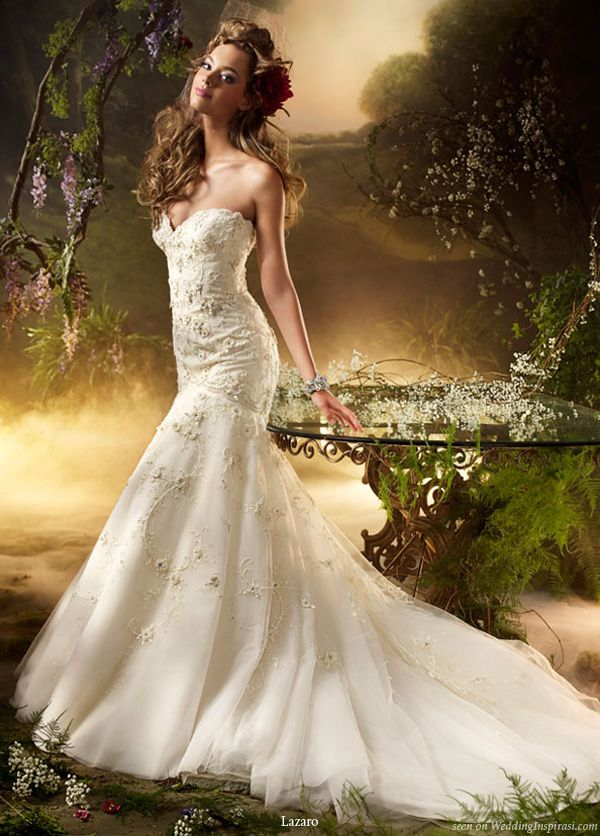 Ivory hand beaded and embroidered tulle formal bridal gown with floral accents, sweetheart   neckline, elongated bodice with circular skirt, chapel train. From Lazaro