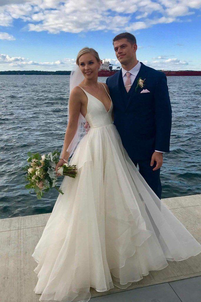 Photo of Simple V Neckline A-line Backless Ivory A Line Beach Wedding Dress