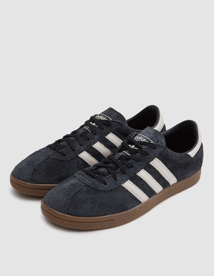 dd08f6aa977c Classic low top sneaker from Adidas in Core Black. Hairy suede upper.  Lace-up front with flat woven laces. Lightly padded collar. Serrated   3-Stripes  and ...