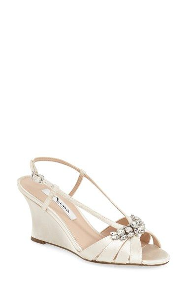 51b286d2746 Free shipping and returns on Nina  Voleta  Wedge Sandal (Women) at Nordstrom.com.  A sparkling brooch elevates a sophisticated evening sandal set on an ...