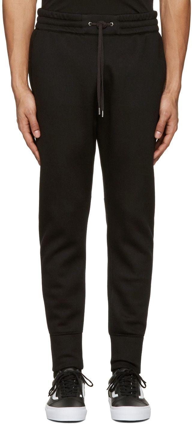 efa1d691f5860c HELMUT LANG Black Curved Leg Track Pants.  helmutlang  cloth  pants ...