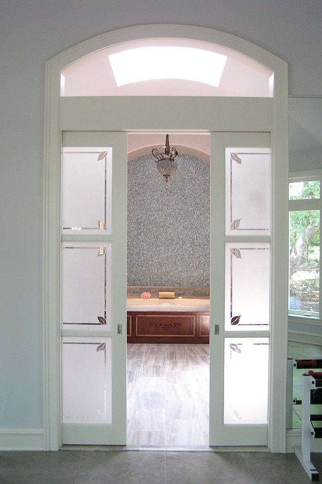 Glass pocket door for toilet compartment to let in light would mosaic tile behind tub skylight and nice frosted glass pocket doors master bathroom dallas greenway renovations planetlyrics Image collections