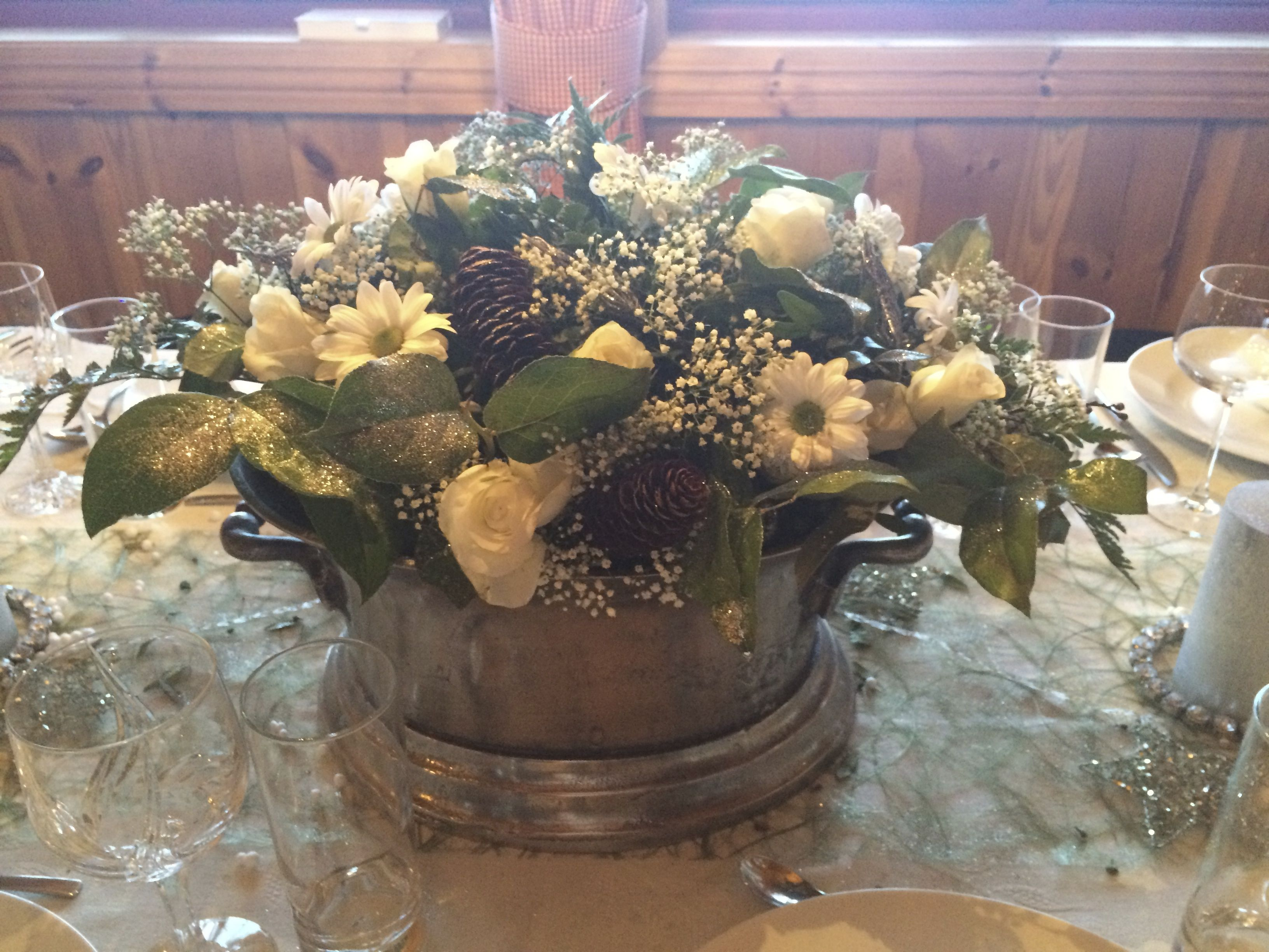 Flower arrangement in a Champagne bucket/cooler.
