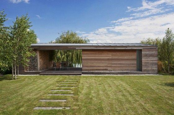 Diseño de cabaña construida en madera, moderna estructura exterior - fachada madera