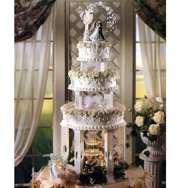 wedding cakes with pillars and fountains 1 wedding cake 3 tier surrounded by flowers 26079