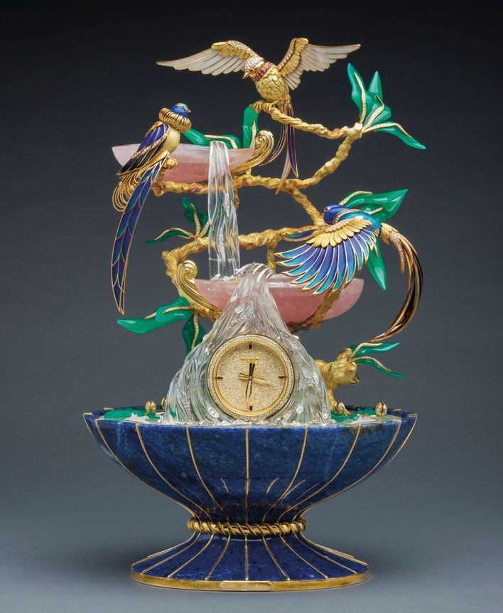 PATEK PHILIPPE 'THE BIRDS OF PARADISE FOUNTAIN CLOCK'. A Magnificent and Spectacular Yellow Gold, Silver, Diamond, Ruby, Rock Crystal, Chrysoprase, Rose Quartz, Sodalite and Enamel Three Birds of Paradise Fountain Clock, of Exhibition Quality Made in 1991. Ref: 2050 MVT 8453 Case 2900530