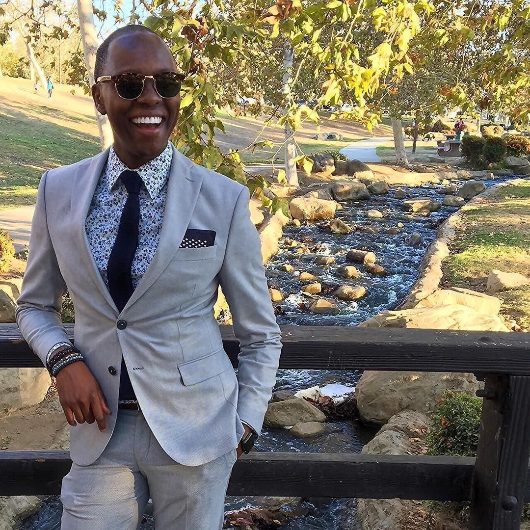 _______self / less  Page 276.  Wool Suit / @HugoBoss Print Dress Shirt / @Etro  Silk Tie / @benshermanofficial  Silk Pocket Square / @HM Time Piece  / Apple Watch Series 1 Bracelets / @OurSaints Club Master Sunglasses / @RayBan