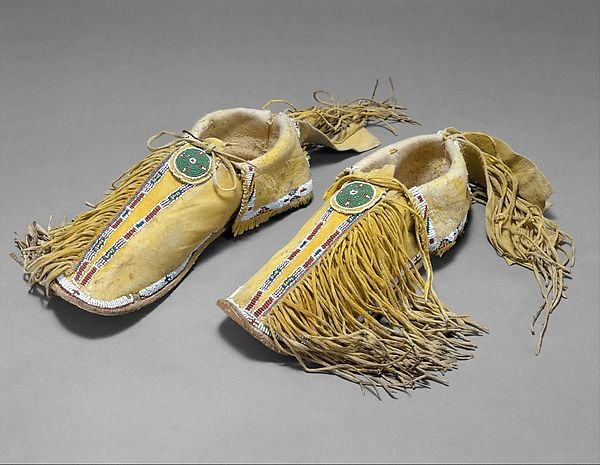 Pair of Moccasins (image 1) | Kiowa | Native-tanned skin, dye, glass | Metropolitan Museum of Art | Accession Number: 2011.154.109a, b