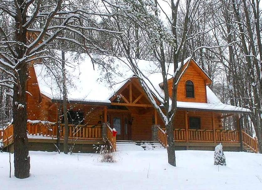 Log cabin with a huge stone fireplace on a small lake or