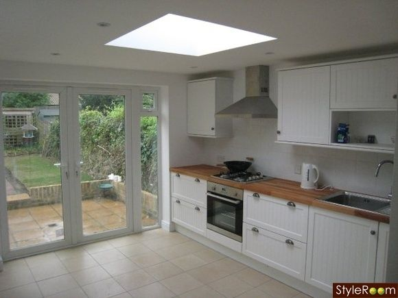 Kitchen door to patio image 2 kitchen patio doors for Kitchen entrance door designs