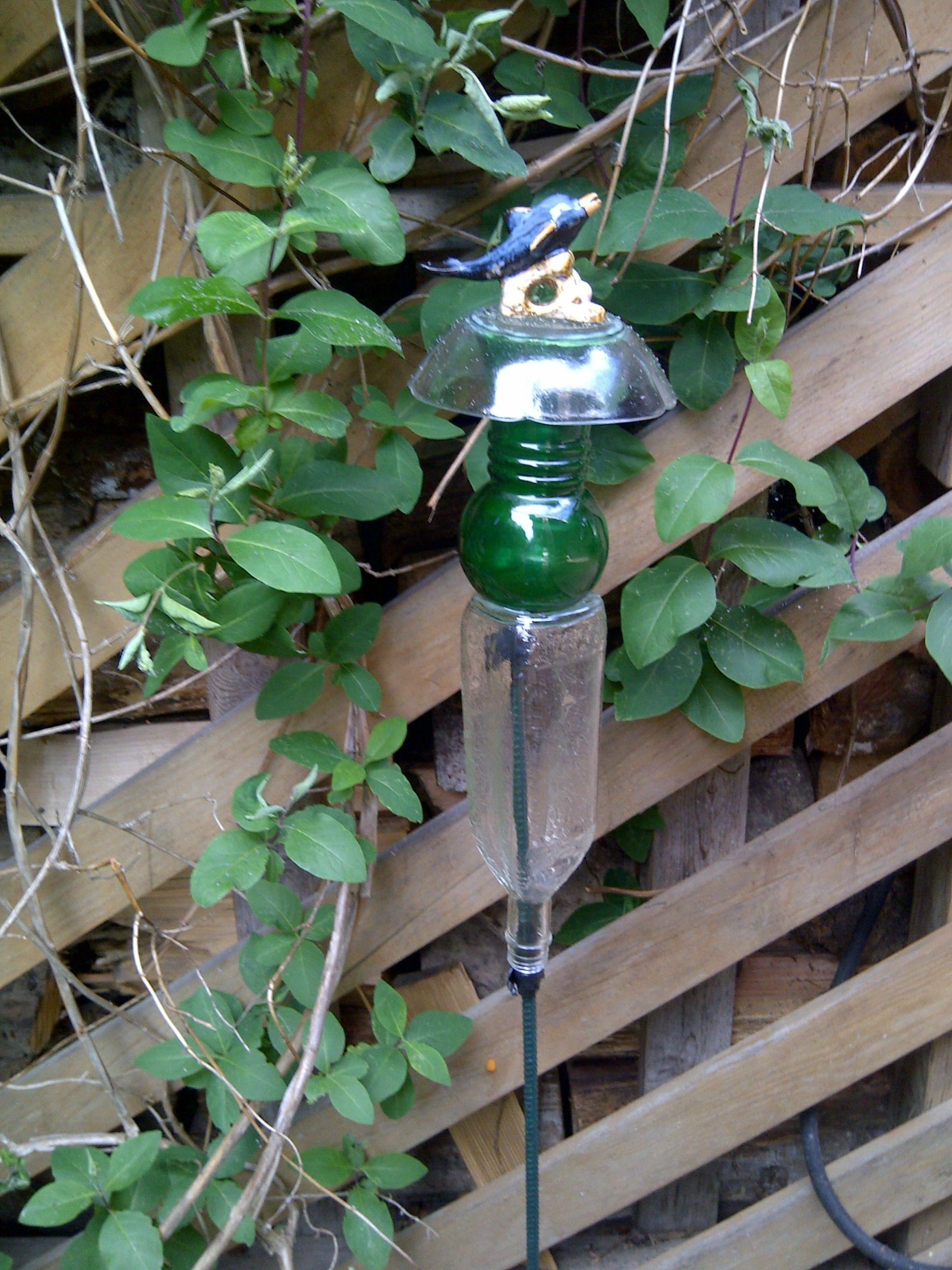 Garden Glass Ornament from found items.   Glass garden art ...
