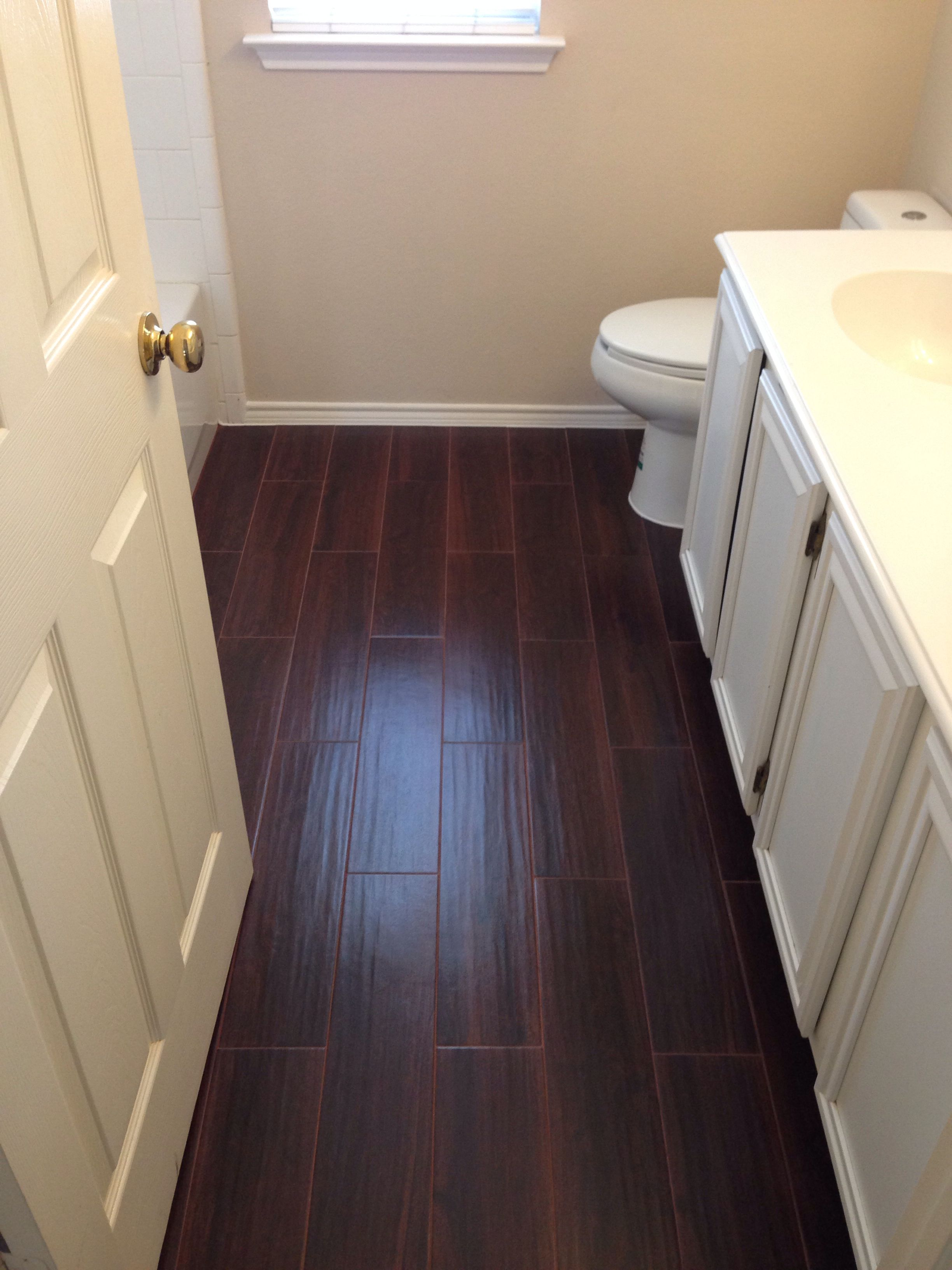 We used porcelain tile that looks like hardwood for our
