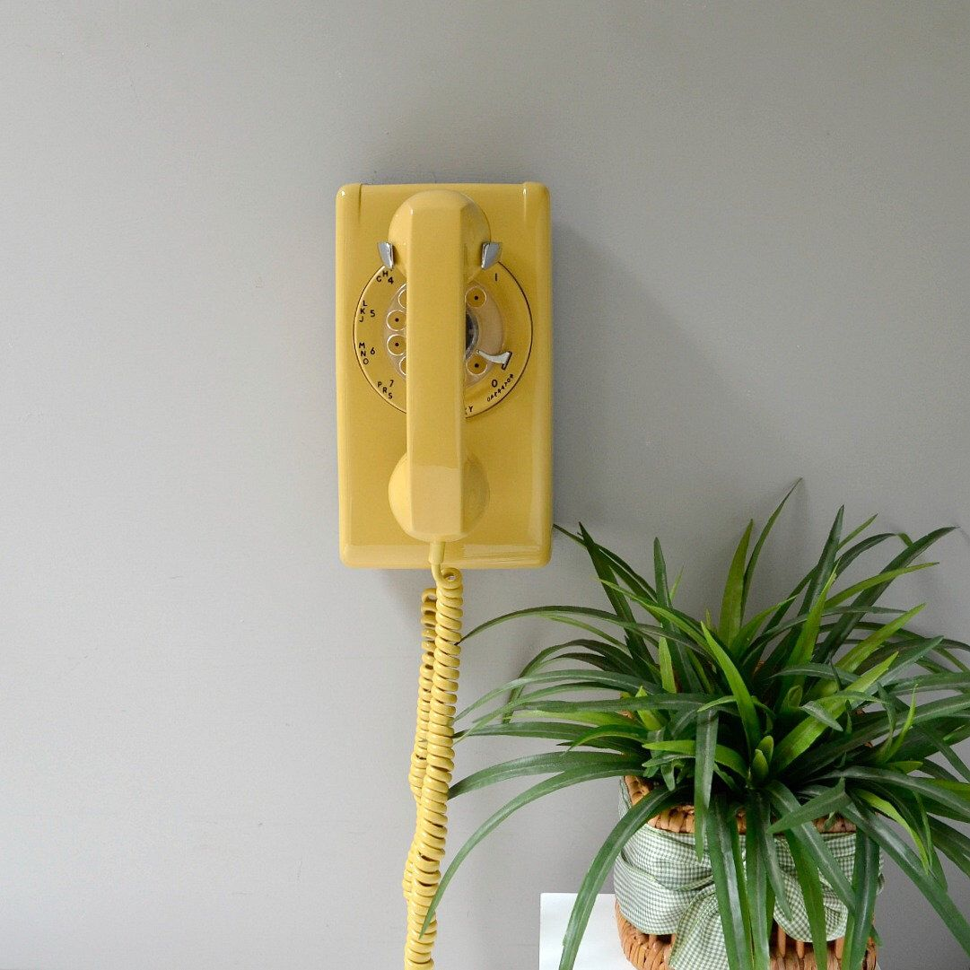 Rotary wall phone; working wall phone; harvest gold rotary dial wall telephone; wall mount retro telephone in yellow #wallphone
